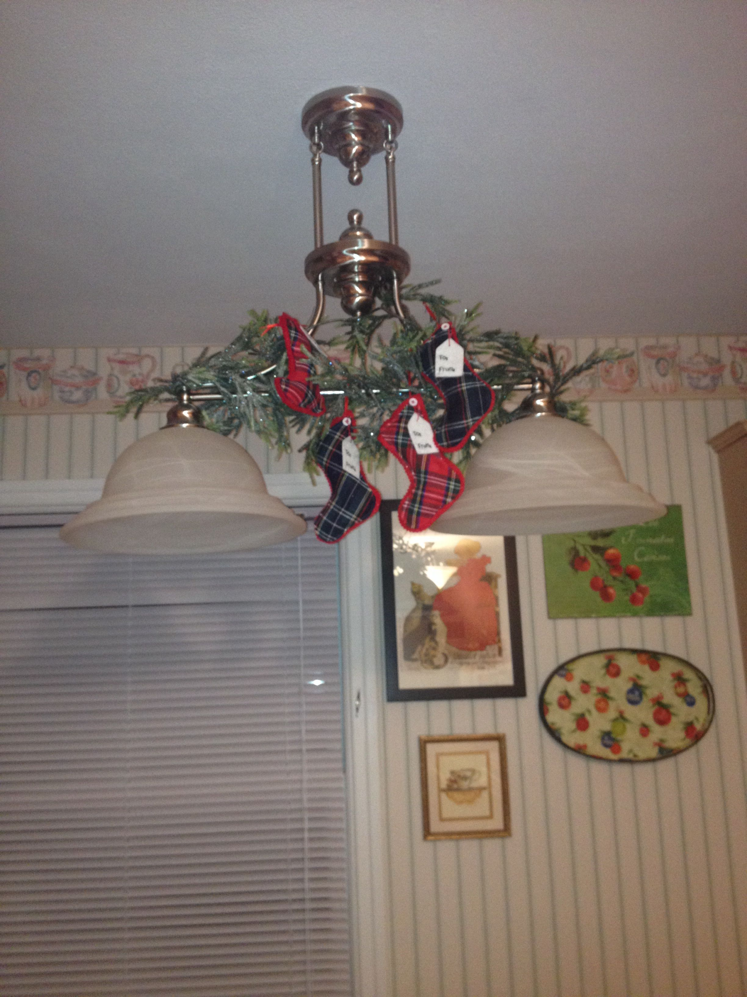 Kitchen chandelier with stockings!