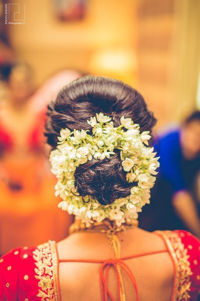 Braided Bun Hairstyle With Gajra Flowers Hairstyle With Flowers White Flowers Gajra Hairdo Indian Bride Hairstyle Flowers In Hair Bride Hairstyles