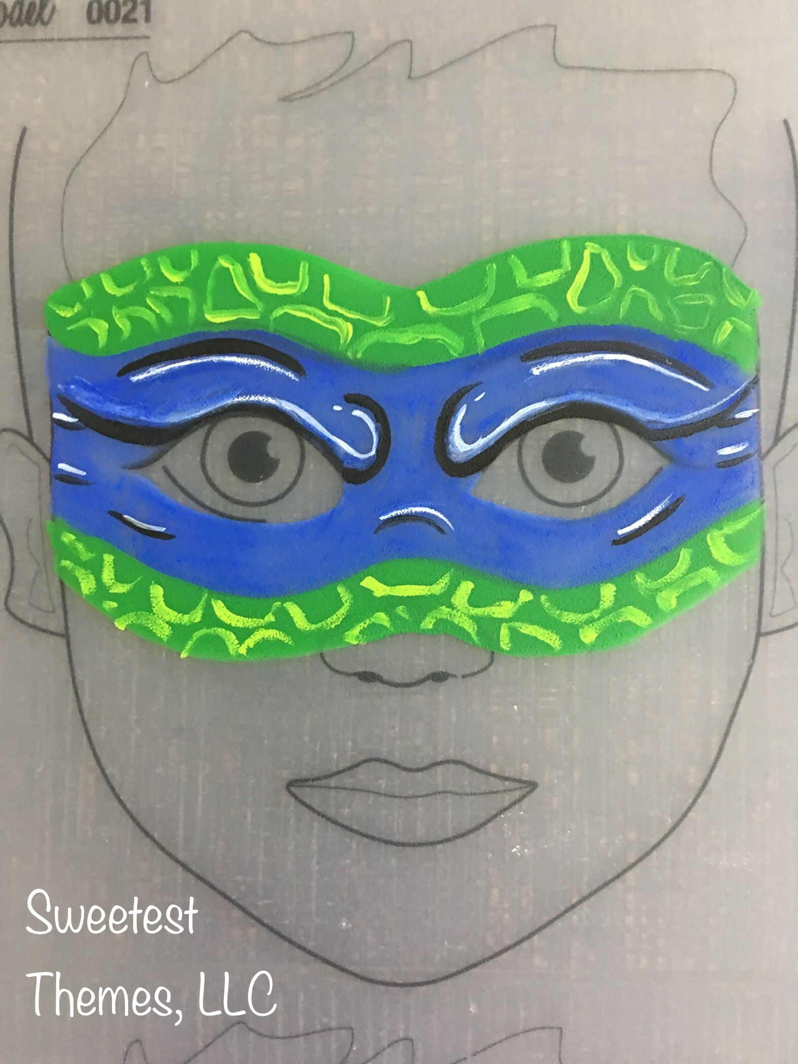 Green and blue Ninja face painting Sweetest Themes LLC