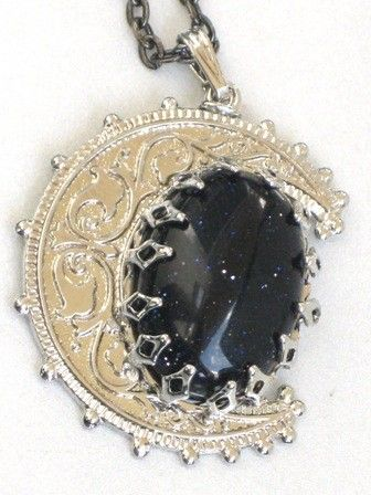 """Enjoy the Shimmer and Sparkle of the Heavens at Night even when the sun comes out.    This stunning blue gold stone cabochon is set in a vintage silver moon setting.  Pendant is suspended from an 18"""""""