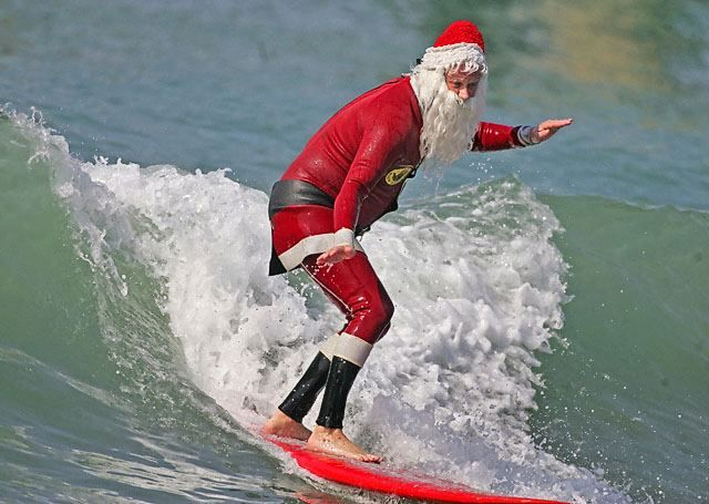 Santa surfing on the beach. #winter