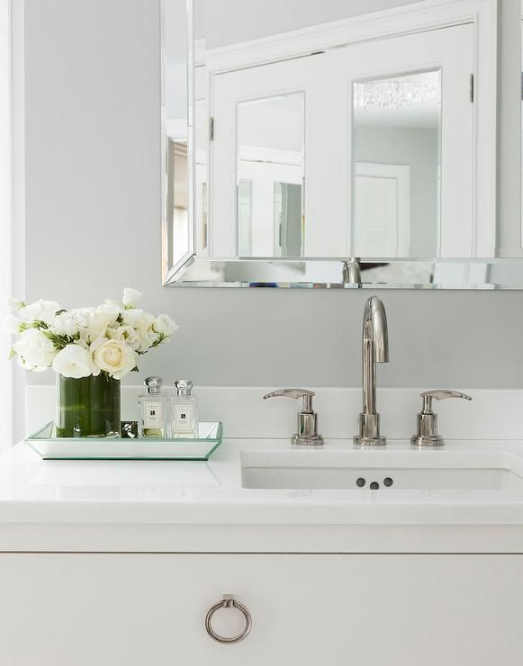 White And Gray Bathroom Features A Gray Wall Lined With A Beveled Vanity  Mirror Over A Idea