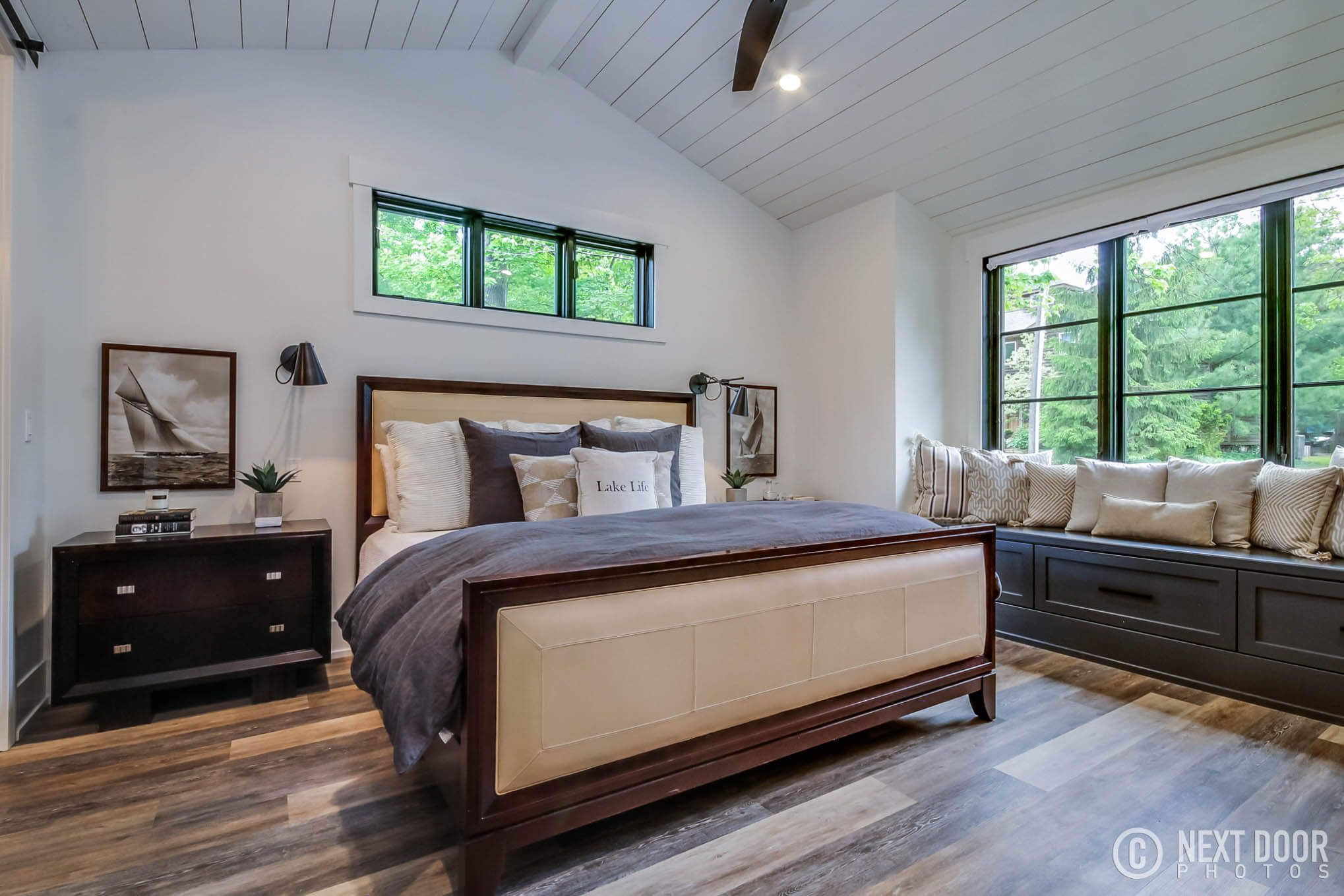 Master Bedroom With Window Seat, Ship Lap Ceiling, Black Windows