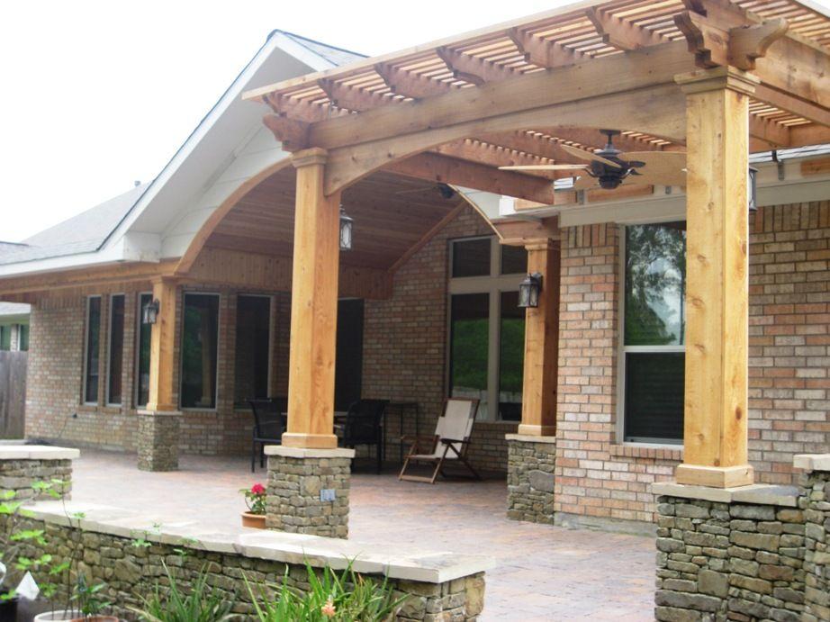 Custom cedar pergola with ledgestone pedestal bases seat for Gable patio designs