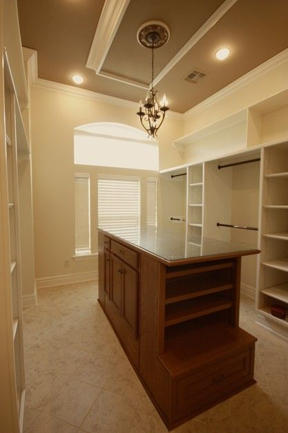 This Walk In Closet Features Shelves, Drop Down Ceiling, And A Center  Island.