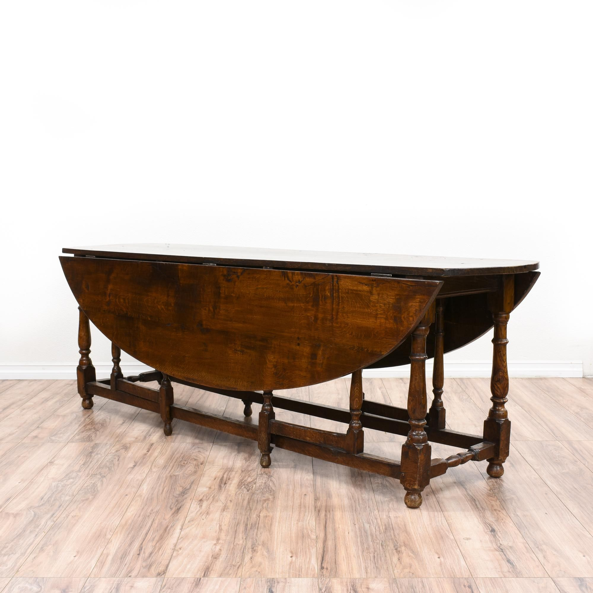 This Antique Drop Leaf Dining Table Is Featured In A Solid Wood With Glossy Oak