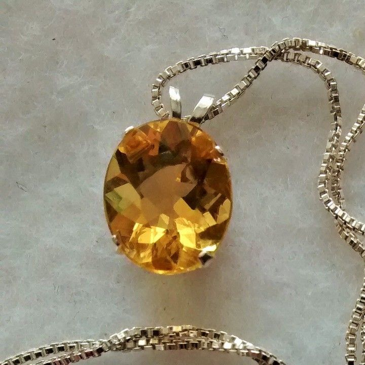 brazillian fire opal pendant and chain from Dynasty Jewelry for $120 on Square Market.....very scarce gem