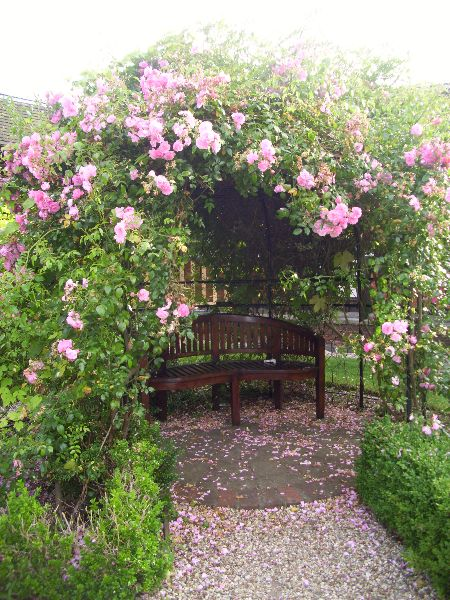 Rose arched seating area maintained by us