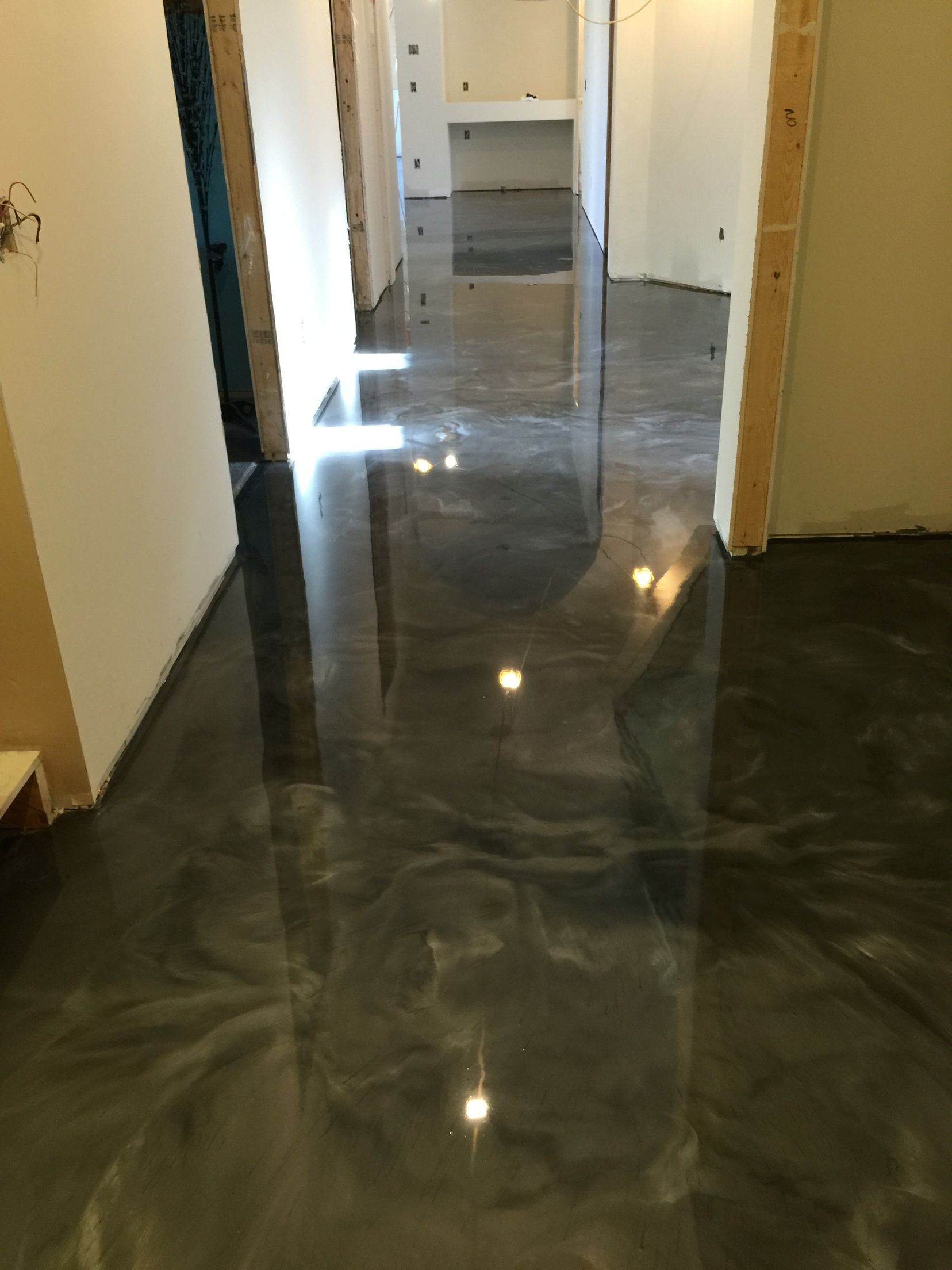 Metallic epoxy floor coating by sierra concrete arts for Concrete floor covering