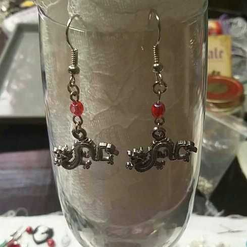 Handmade Chinese dragon charm earrings with red glass beads. A little under two inches long. $3