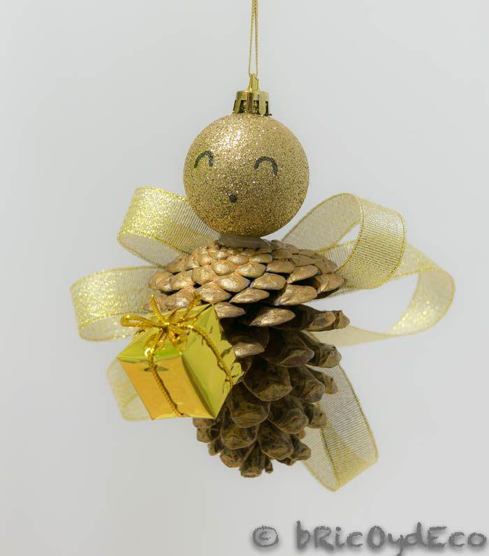 Ngel hecho con pi as de pino feliz navidad - Manualidades pinas secas ...