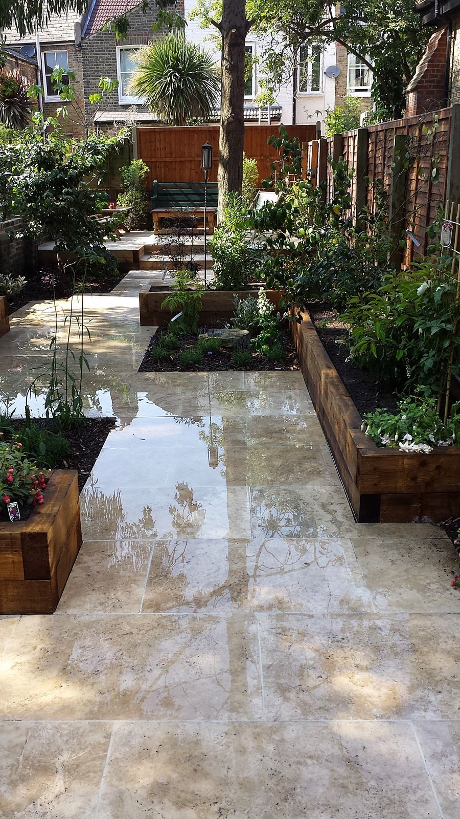 Travertine paving patio garden wandsworth london raised for Modern low maintenance garden ideas