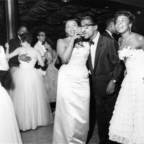 Dinah Washington - Singer Dinah Washington and entertainer Sammie Davis Jr. share the dance floor at an event.