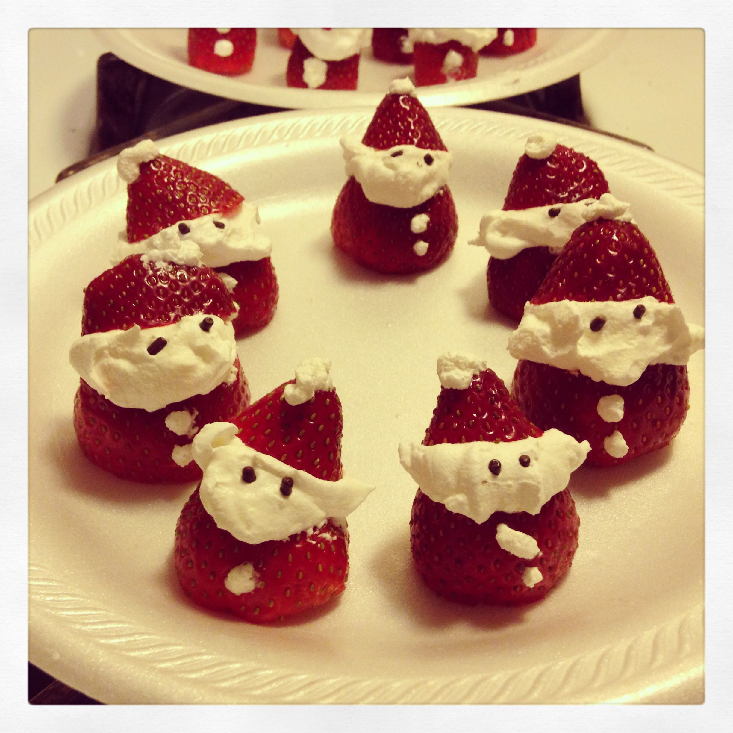 Santa Claus strawberries... cool whip and strawberries ... :)