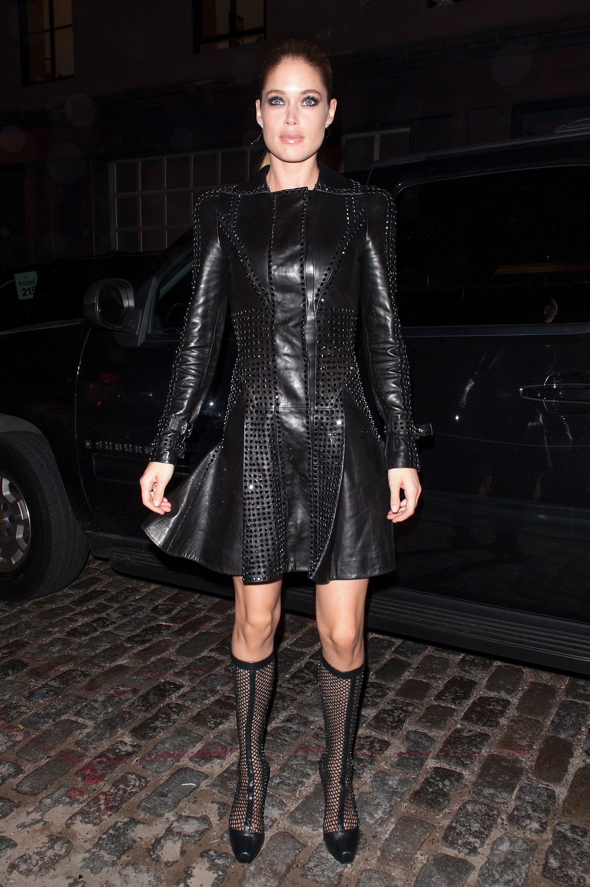 Black dress meaning - Doutzen Kroes S Black Studded Versace Coat Dress Gives New Meaning To The Term Babe In
