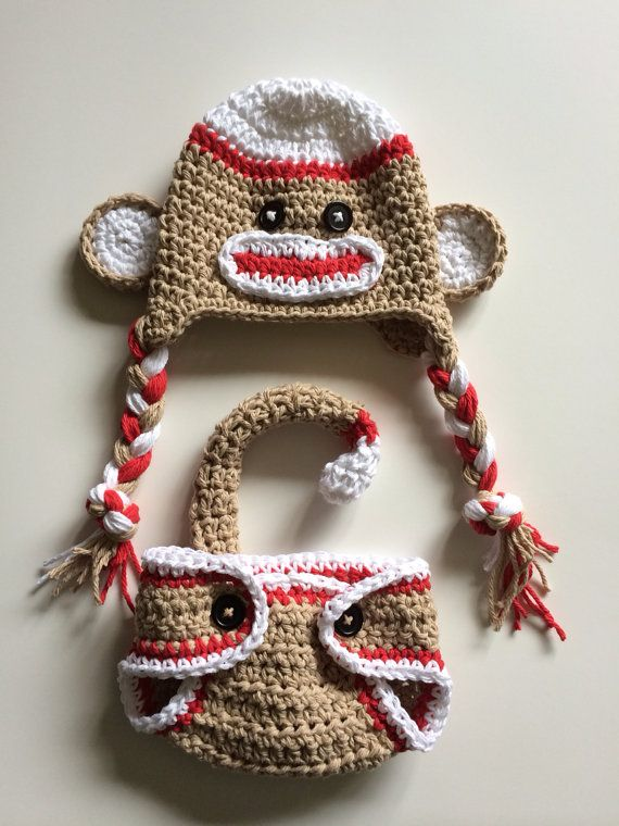 Sock monkey hat, red sock monkey, diaper cover, diaper cover set, newborn sock monkey, newborn photo prop, Halloween costume, monkey hat This listing is for a crochet red sock monkey hat and diaper cover. It even comes with a bendable tail to add to the cuteness! The diaper cover is