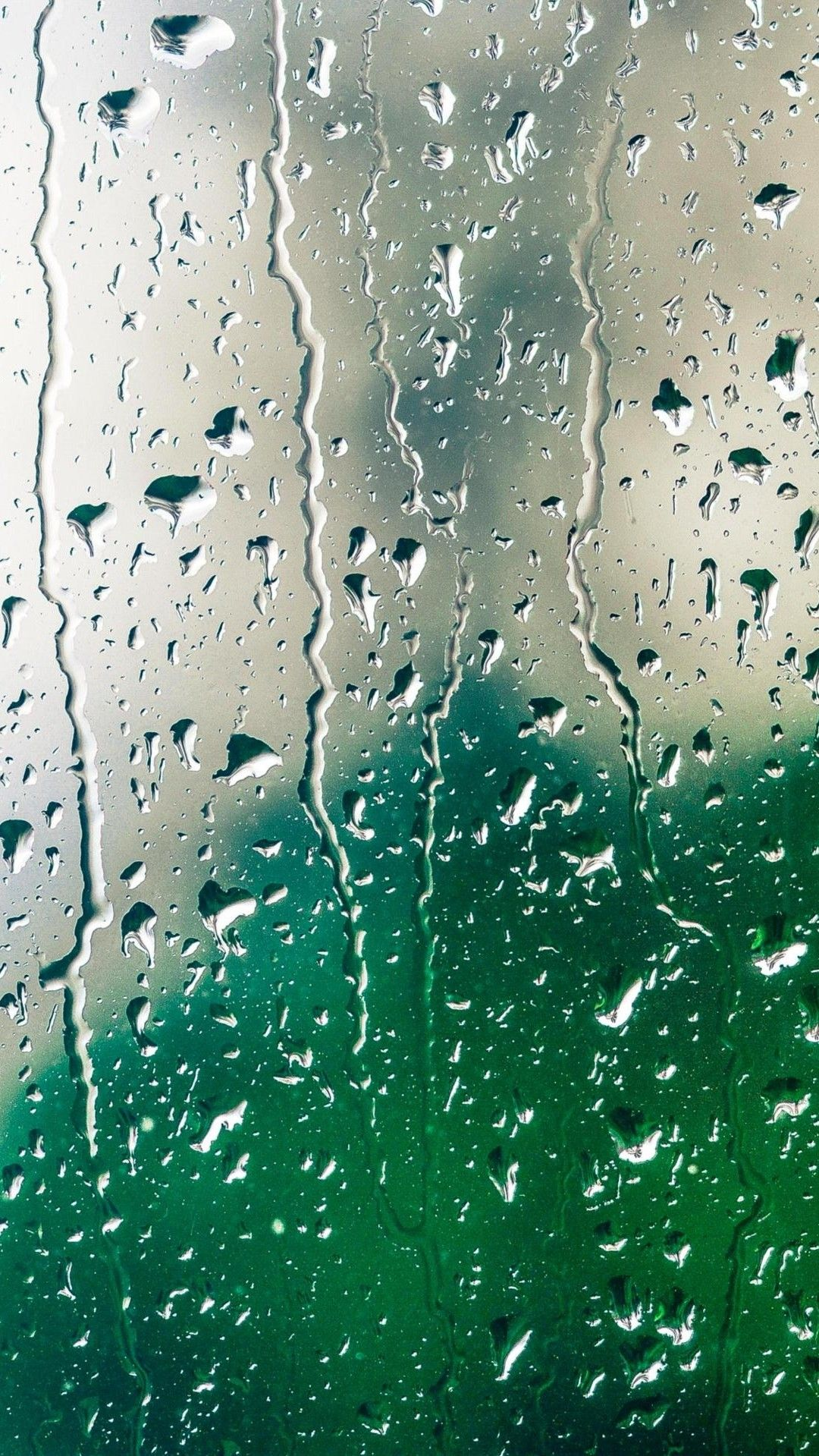 Wallpaper Of Water Drops With Lighting Reflections On Window