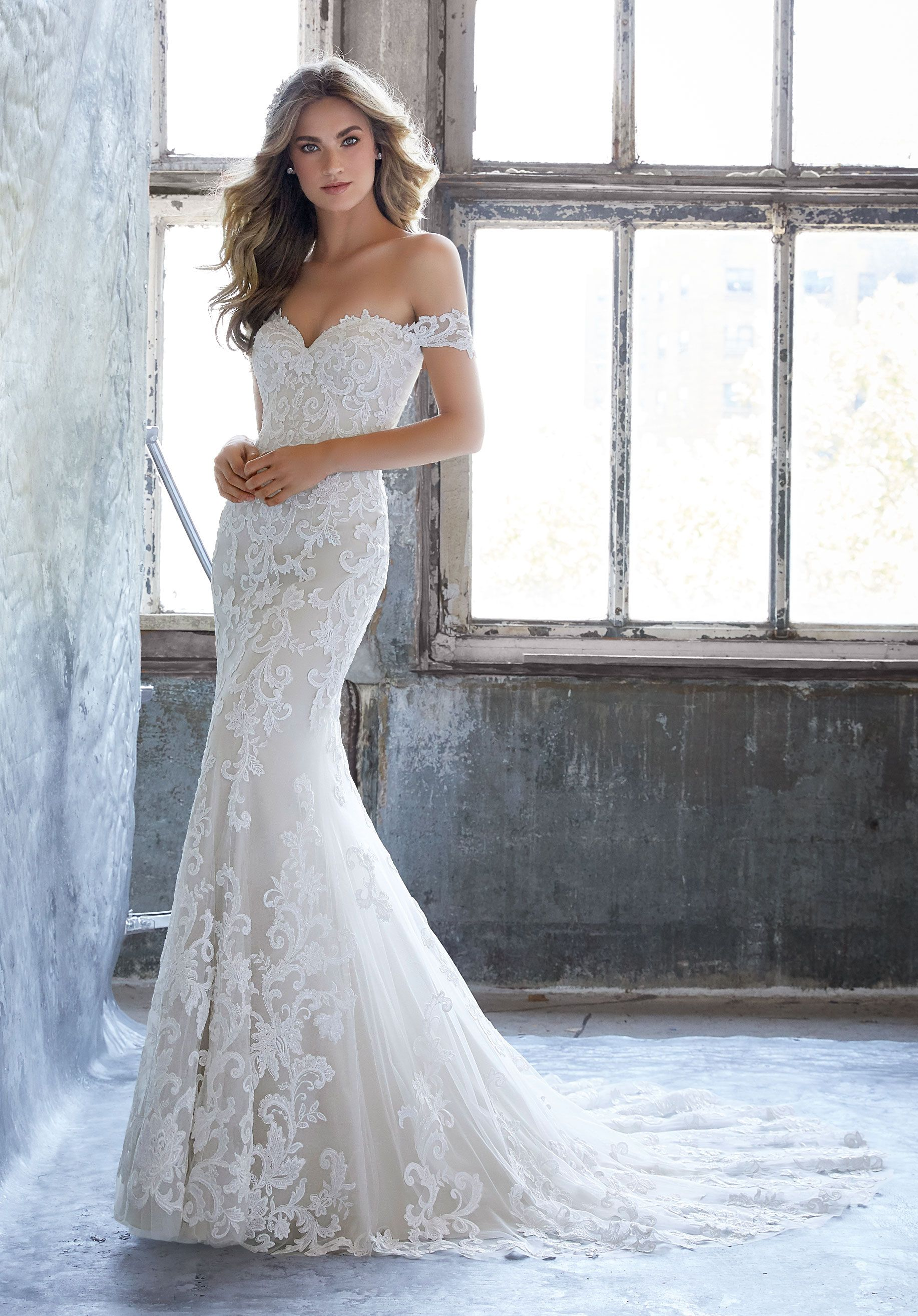 Frosted Lace Appliqués on Net. Available in Three Lengths: 55\