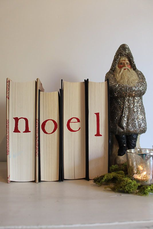 Just turn your books around for a no cost holiday decoration cut turn your books around and attach letters for a low cost but totally cute display or buy old books cover with christmas wrapping paper and stencil or spiritdancerdesigns Gallery