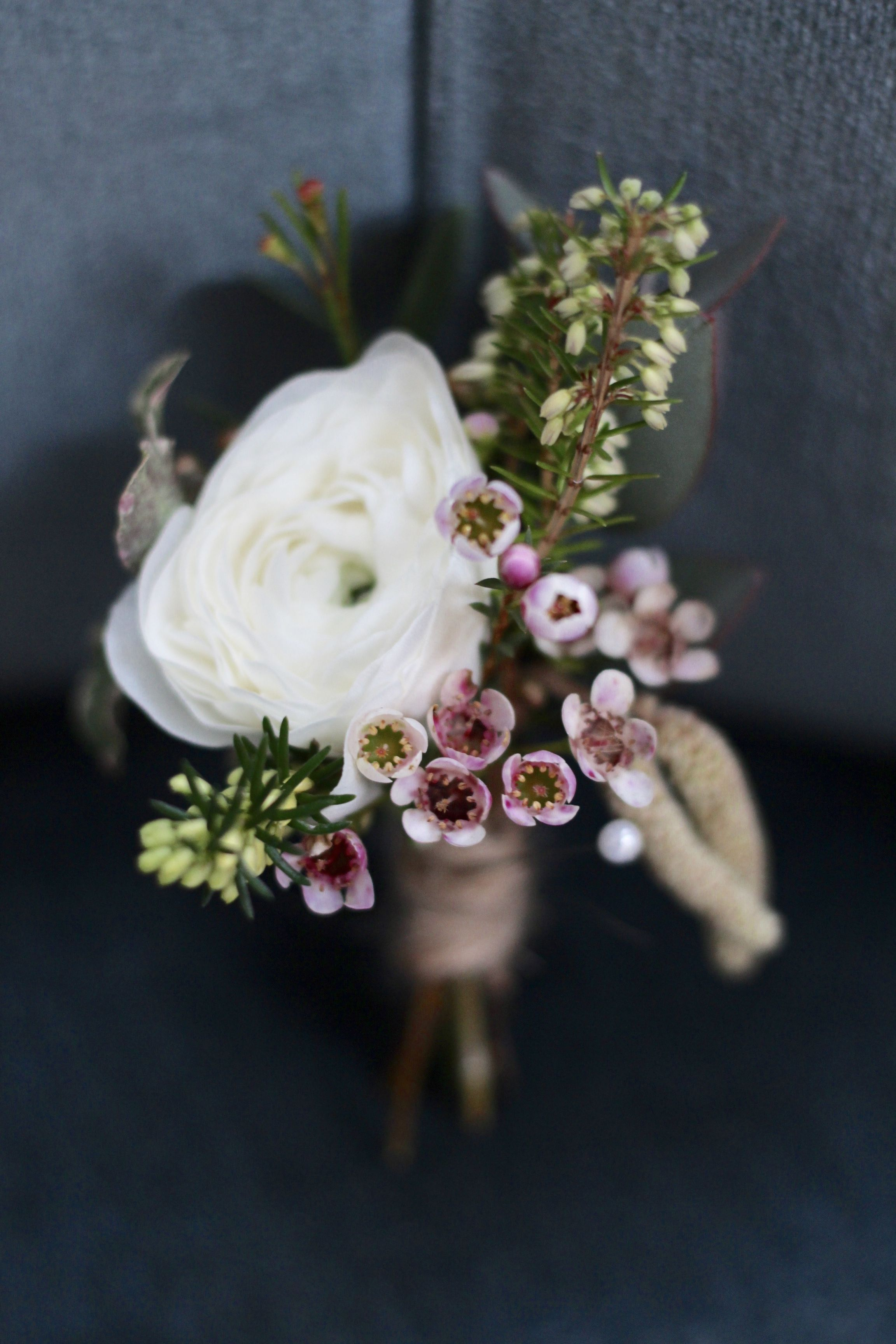 White Ranunculus With Heather And Wax Flowers For A Wedding Buttonhole White Wax Flower Button Holes Wedding Beautiful Wedding Flowers