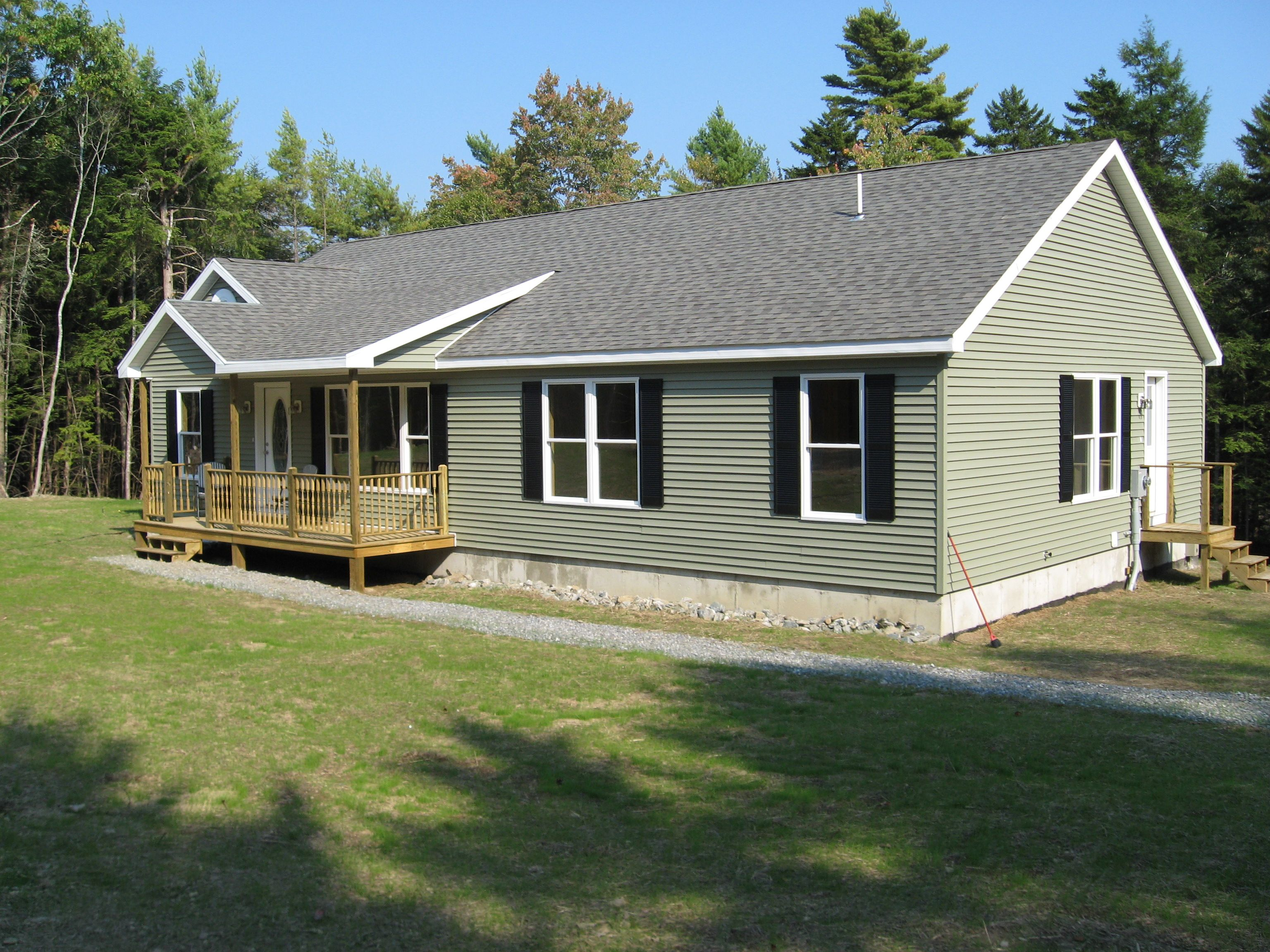 Modular ranch exterior with green siding and black for Ranch homes with vinyl siding