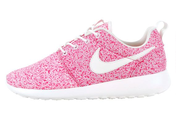pink and white roshe runs