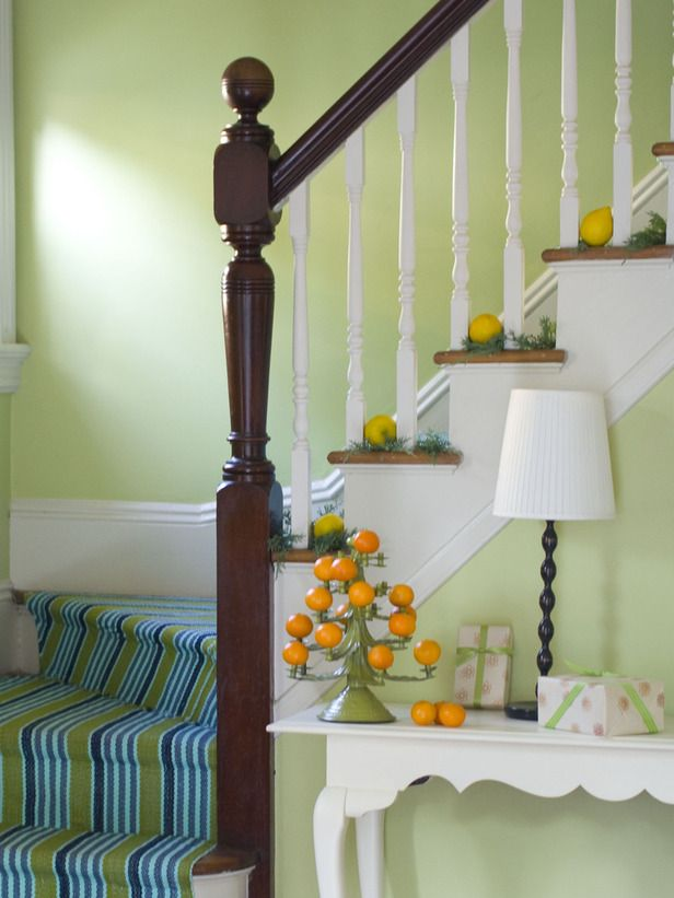 Decorating: Add style interest to the staircase with berries and sprigs of evergreen for a festive touch.