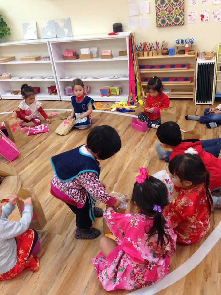 Children share valentines day cards and gifts during