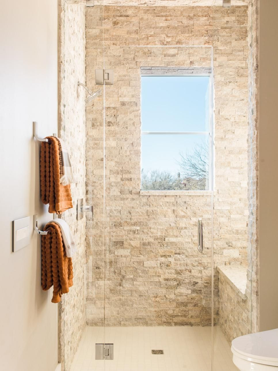 With A Rich Dark Wood Vanity And An Enticing Walk In Shower That
