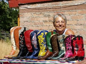 Deanna McGuffin and her boots - she learned the craft from her father ( boot legend) L. W. McGuffin. Shop in New Mexico. She also teaches boot making.