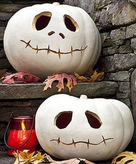 White jack-o-lanterns with personality See more fun Halloween facts - fun halloween decorating ideas