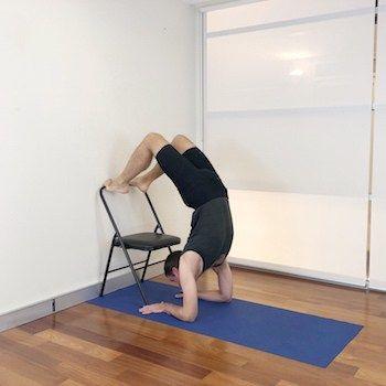 vrschikasana scorpion pose  iyengar yoga  stoel yoga