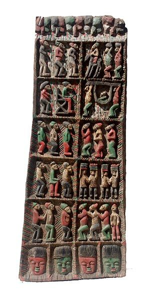Africa | Yoruba doors, often made by well-known carvers for prestigious homes and palaces, usually have strong figurative carving in deep relief. This one retains most of its original paint as well | © Tim Hamill