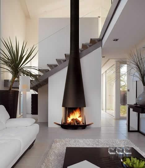 well placed fireplace, open design for heating and the exposed stack