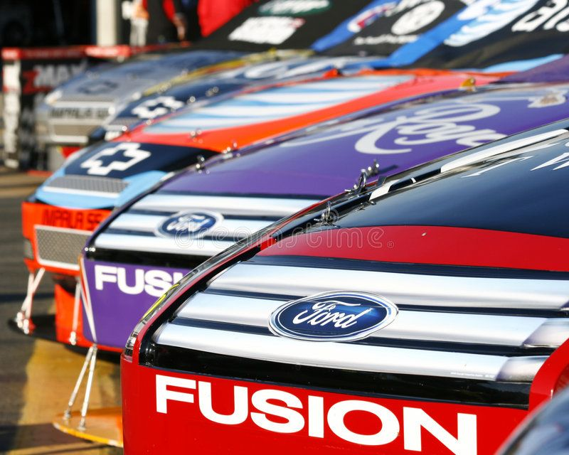 Nascar American Muscle Cars Nascar Cars From Ford And Chevy Waiting In The Ga Sponsored Cars Ford Chevy Cars Nascar Ad American Muscle Cars