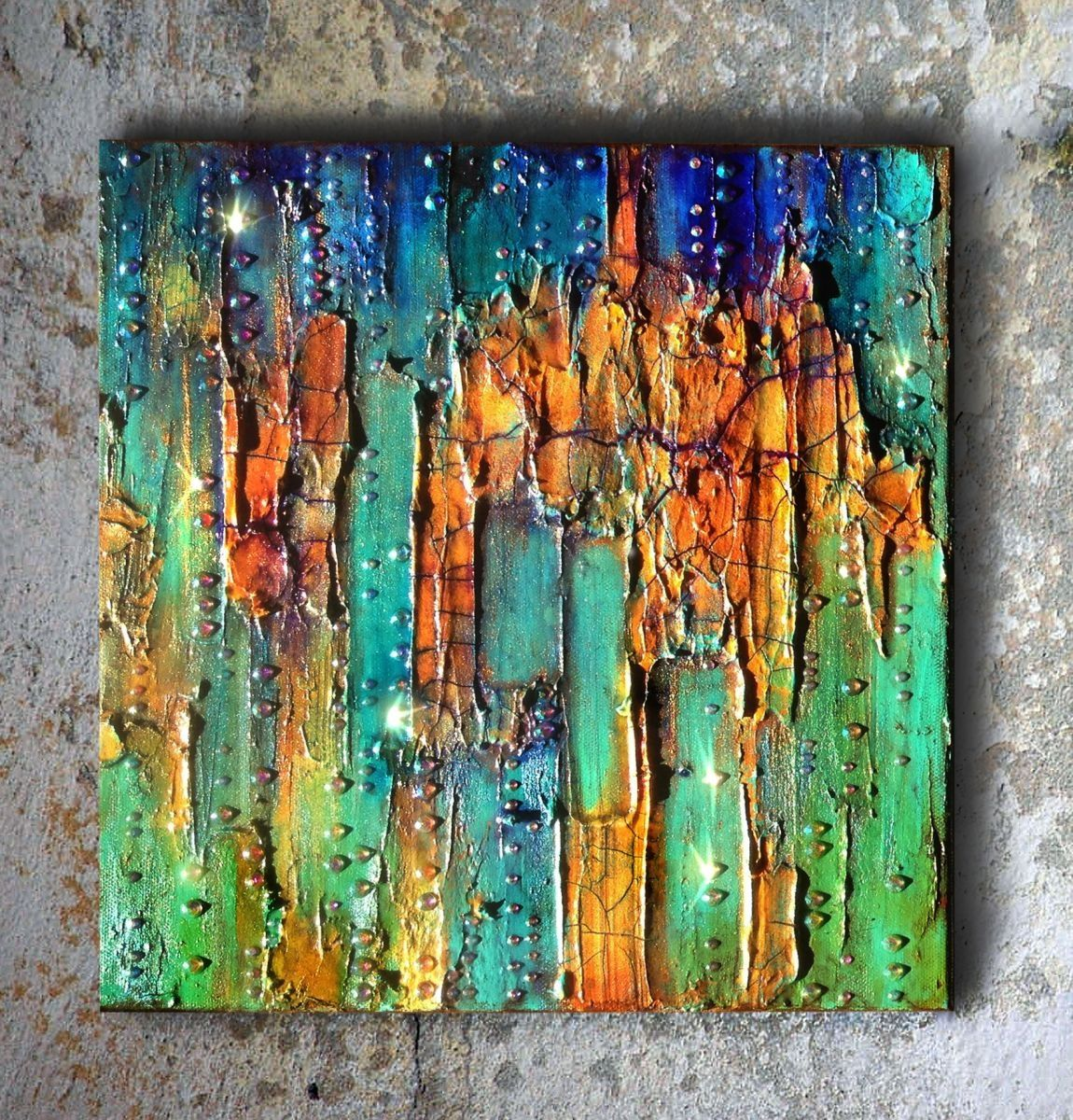 This unusual mixed media diptych painting is titled Emerald City #1. This piece has thick layers of paint in a variety of colorus, rhinestones, modeling and crackle paste. I have always felt that ...