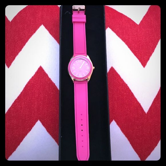 Quartz watch with pink silicone wrist band.  NEW!! Quartz watch with pink silicone straps and gold  colored accents. Protective clear covering still on the face and back of the watch.  ONLY serious offers will be considered.!!!! Accessories Watches