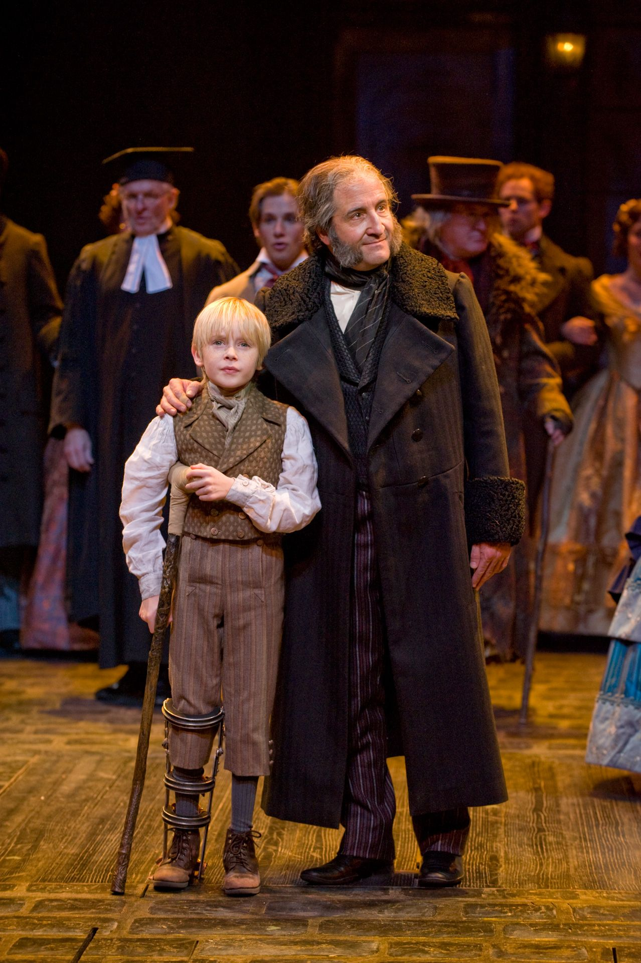 J.C. Cutler as Ebenezer Scrooge with Noah Ross as Tiny Tim. A ...