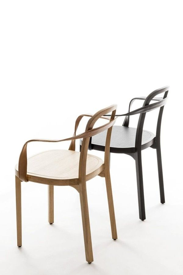 A Wooden Chair With A Curvy Leather Armrest Wood Chair Design