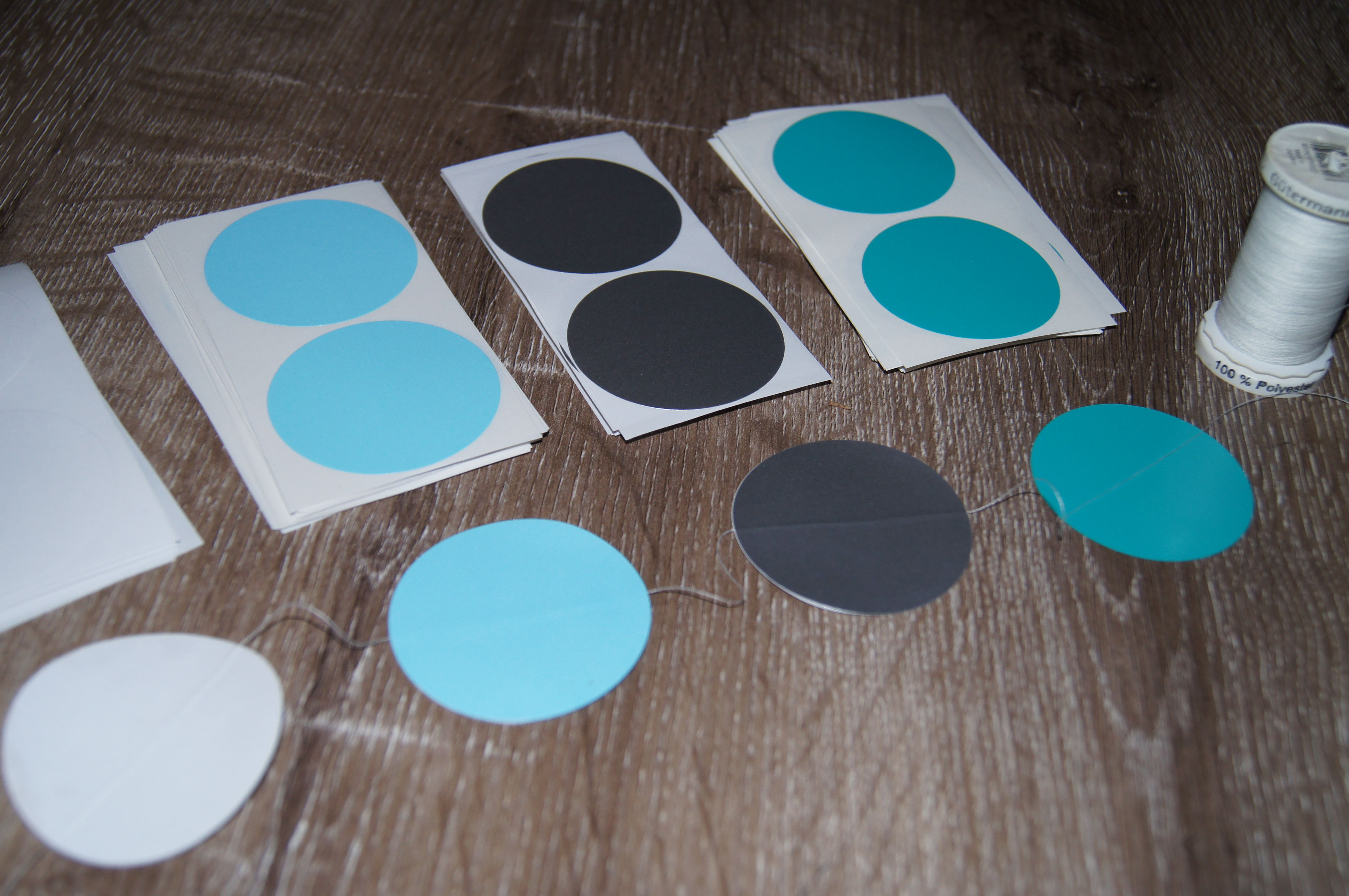 DIY dot garlands. 50mm round stickers and cotton.
