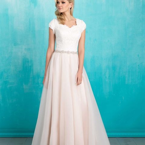Style: M550 - Dreamy tulle and a bow at the back make this A-line ...