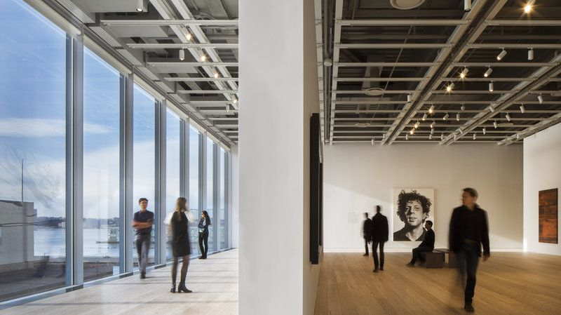 The new building's window-lined hallways are in stark contrast to the brutalist design of the Whitney's former home.