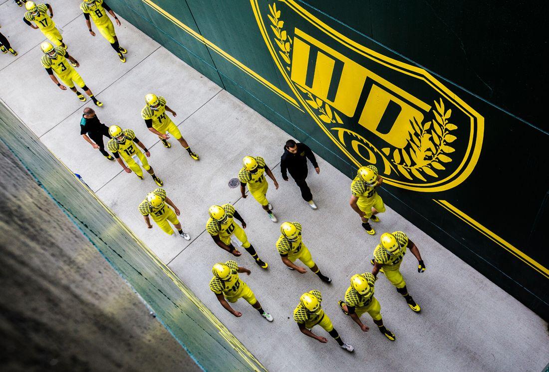 The Oregon Ducks enter Autzen Stadium for warmups before