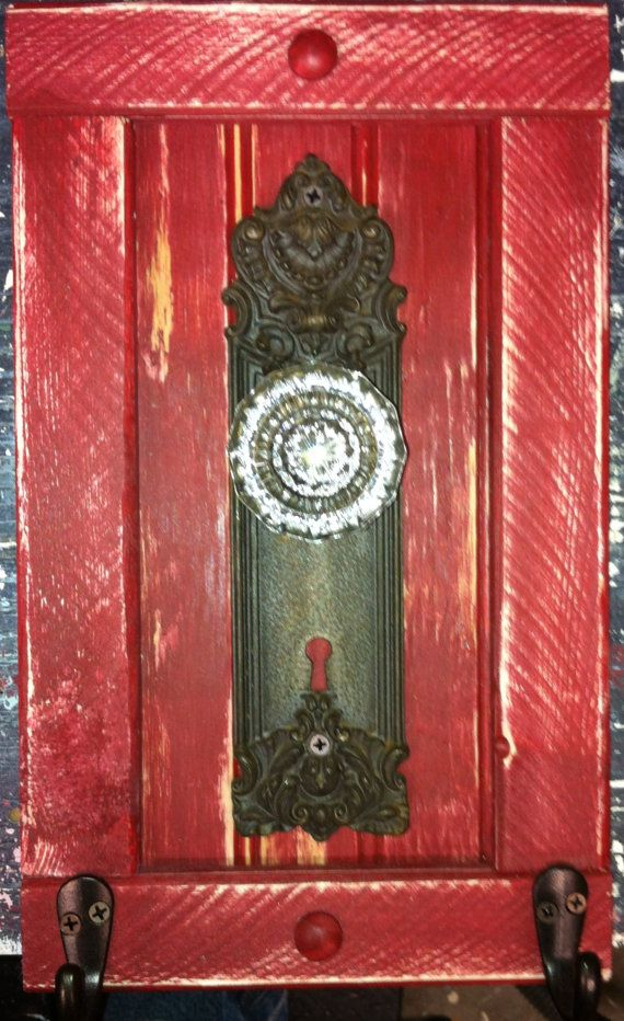 antique door knob and plate repurposed into coat towel hanger