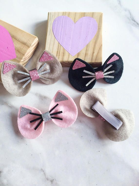 Too Cute! Little felt cats ears are adorned with glitter fabric and a glitter ribbon centre to create the perfect little