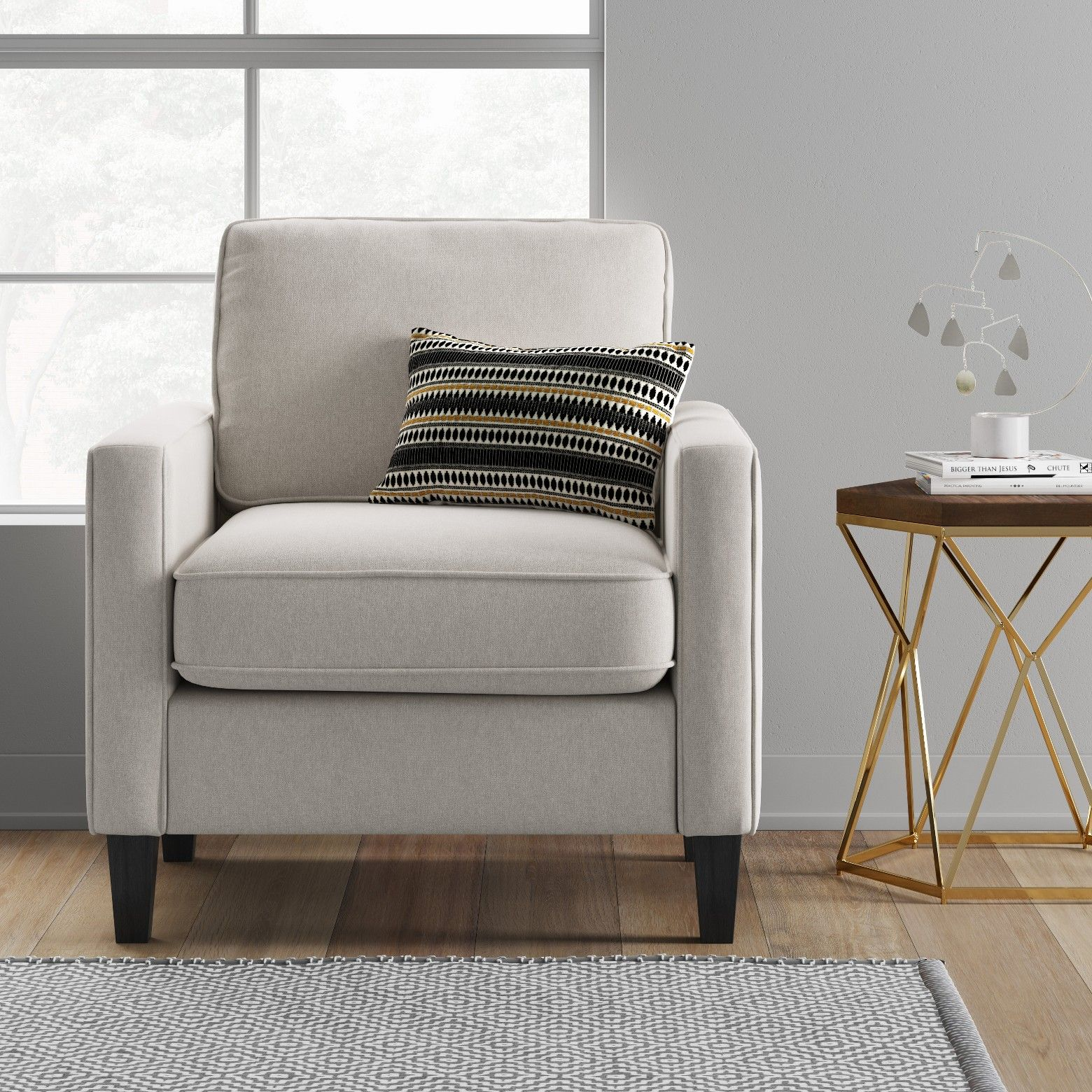 Furnish your space in style with this elmhurst modern loose back cushion beige chair from project 62 this modern armchair features clean lines and wood
