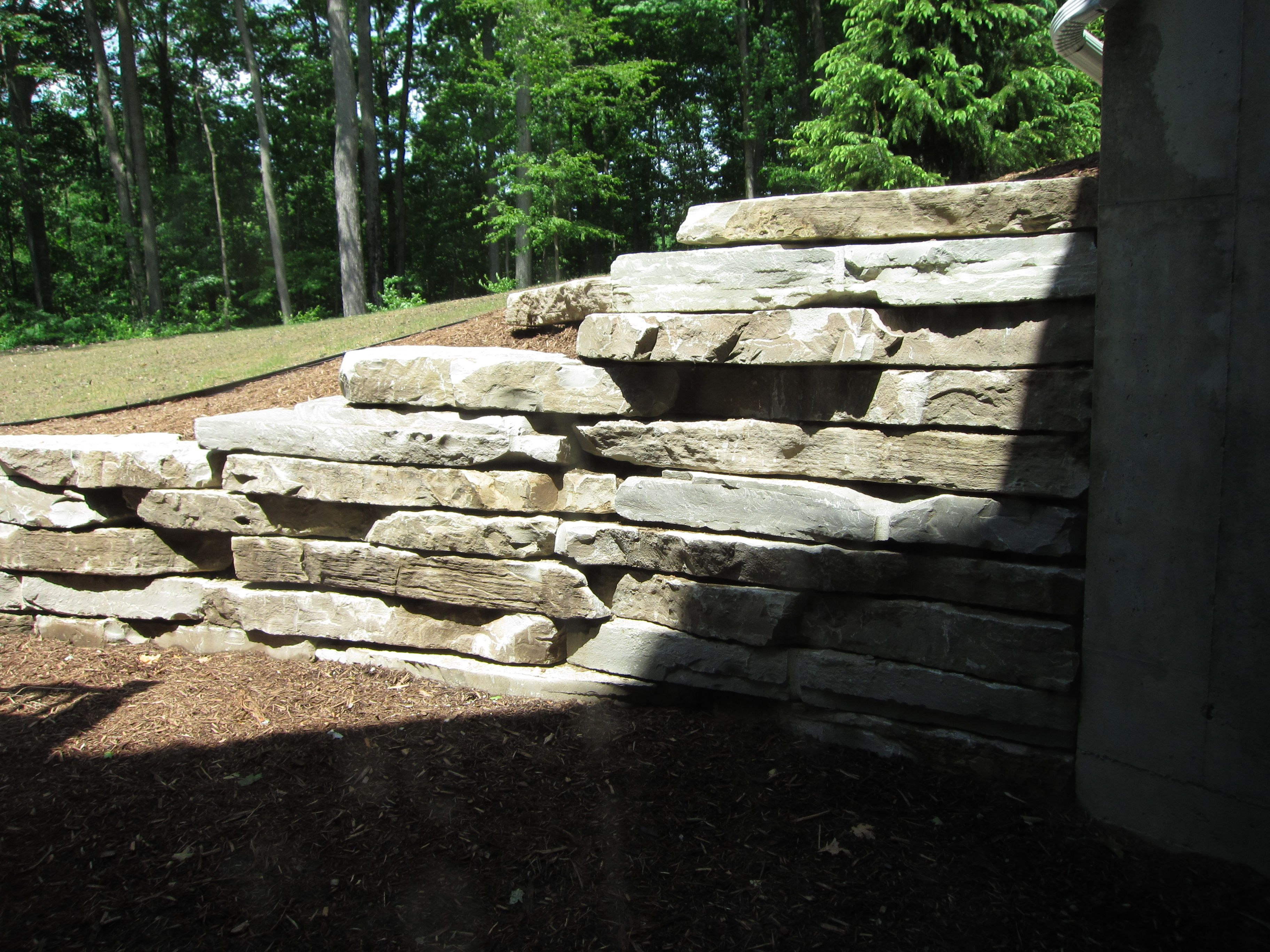Stone retaining wall for outside walkout or daylight for Walkout basement retaining walls