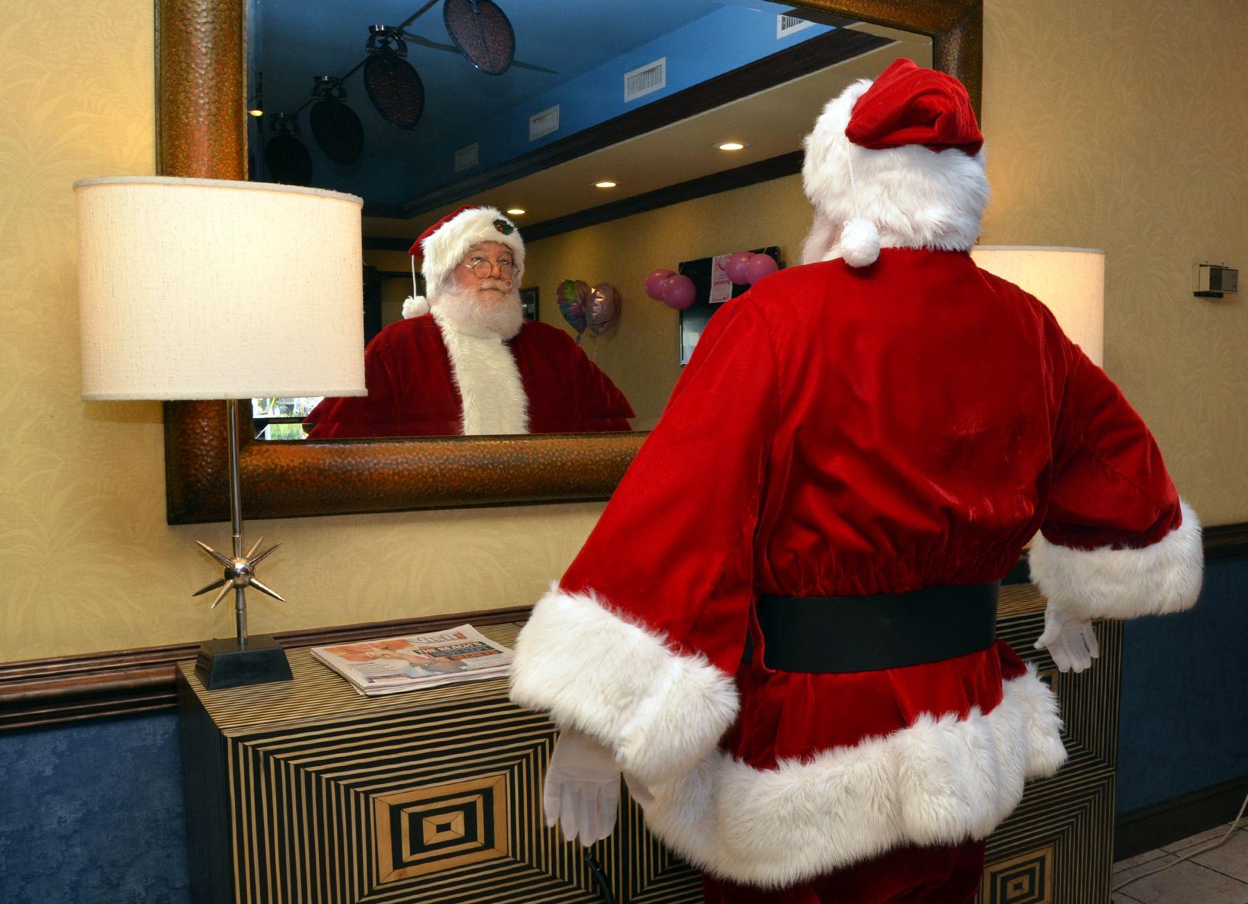Santa admires himself in the mirror. #fun | Santa Visits Myrtle ...