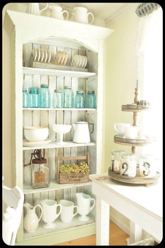 Find an old Cupboard, Cabinet, or Hutch and paint it a pretty Aged White and it's perfect for some extra Kitchen Storage!