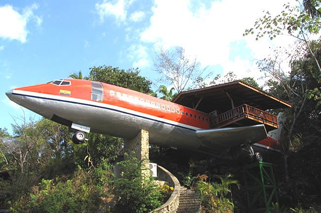 """While sleeping comfortably on an actual flight can be challenging, hoteliers offer gracious accommodations on grounded, converted models. At Costa Rica's Hotel Costa Verde, for example, a retired 1965 Boeing 727, soaring 50' high, offers unobstructed views of the rainforest and ocean. """"Executive Suite 727"""", accessible by spiral stairs, is an air-conditioned two-bedroom suite that sleeps six and features Java teak paneling, a kitchenette, and a large deck."""
